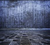 stock photo of stonewalled  - grungy stone or concrete room in blue tone - JPG
