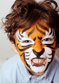 pic of cute tiger  - little cute boy with faceart on birthday party close up - JPG