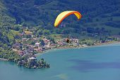 stock photo of annecy  - paraglider flying over Lake Annecy in France