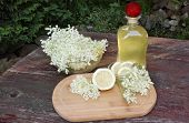 picture of elderberry  - Syrup of flowers elderberry on wooden table - JPG