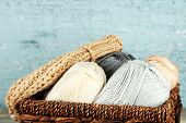 foto of knitted cap  - Knitting yarn and cap in basket - JPG