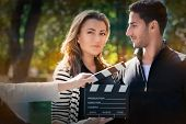 foto of role model  - Young couple shooting a romantic scene outside - JPG