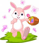 stock photo of easter basket eggs  - Vector illustration of Easter Bunny Hiding Eggs - JPG