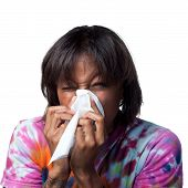 stock photo of swine flu  - Sneezing into a tissue - JPG