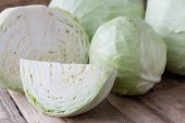 picture of cruciferous  - Head of cabbage and cutted cabbage on old wooden desk - JPG