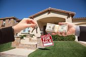 foto of eviction  - Handing Over Cash For House Keys and Short Sale Real Estate Sign in Front of Home - JPG