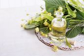 picture of linden-tree  - Essential aroma oil with linden on wooden background - JPG