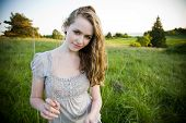stock photo of teenage girl  - A beautiful caucasian teenage girl outdoor in summer - JPG