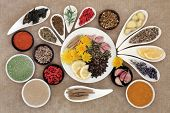 picture of immune  - Immune boosting healthy superfood selection in porcelain dishes over brown  background - JPG