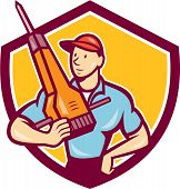 picture of hammer drill  - Illustration of a construction worker hnolding jack hammer pneumatic drill set inside shield crest on isolated background done in cartoon style - JPG