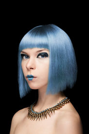 foto of manga  - Anime model girl with blue hair isolated on black background - JPG