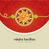 stock photo of rakhi  - Beautiful rakhi with gems on shiny red and beige background for the festival of Raksha Bandhan celebrations - JPG