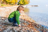 image of pullovers  - Adorable toddler boy playing by the lake on a nice warm and sunny day - JPG