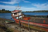 picture of derelict  - Derelict fishing boat stranded on the shore in Castro - JPG