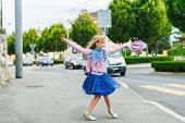 image of dancing  - Adorable little girl dancing in the street - JPG