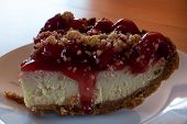pic of crust  - Cherry cheesecake with graham cracker crust on a plate - JPG