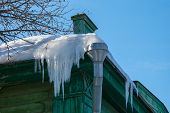 foto of icicle  - Icicles on the roof of an old wooden house - JPG