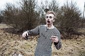 foto of insane  - Dressed like sailor man acting creepy zombie - JPG
