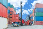 stock photo of lift truck  - Crane Lifter Handling Container Box Loading To Truck - JPG