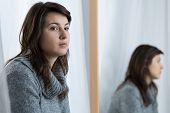 foto of mood  - Young attractive woman in a bad mood - JPG