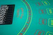 picture of gambler  - Black and white chips awaiting casino gamblers - JPG
