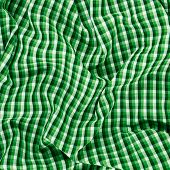 picture of fragmentation  - Wrinkled squared green cloth fabric fragment as an abstract background composition - JPG