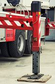 stock photo of stability  - Fire truck outrigger stabilizing legs extended - JPG