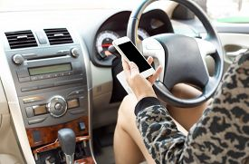 image of unsafe  - Driving and using cellphone is dangerous and unsafe for other people - JPG