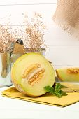 picture of honeydew melon  - Juicy honeydew melon on a wooden table background.