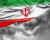 foto of tehran  - Iranian waving flag on a bad day - JPG