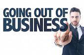 image of going out business sale  - Business man pointing the text - JPG