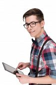 picture of nerds  - Young nerd in glasses and checkered shirt with digital tablet pc isolated on white background - JPG