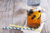 pic of masonic  - Ice tea in mason jar mug with lemon and blueberries refreshing in hot summer day - JPG