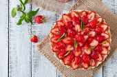 picture of tarts  - Tart with strawberries and whipped cream decorated with mint leaves - JPG