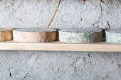 stock photo of basement  - Goat cheese maturing in basement - JPG