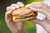 stock photo of hamburger  - woman eating hamburger - JPG