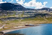 stock photo of fjord  - Old fishing boat that shipwrecked in one of the fjords of the Iceland in the Westfjords  - JPG