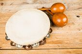 picture of maracas  - Tambourine and maracas on a wooden table - JPG