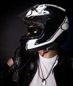 picture of biker  - Portrait of stylish biker over dark background - JPG