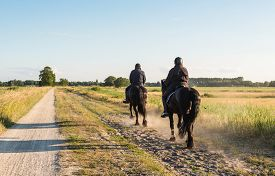 foto of horse-riders  - Two black - JPG