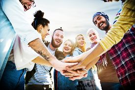 stock photo of joining  - Friendship Join Hands Celebration Summer Beach Concept - JPG