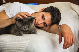 stock photo of cuddle  - Handsome Young Animal - JPG
