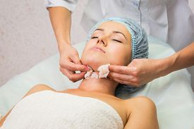 foto of cosmetology  - Girl with a beautician at spa salon - JPG