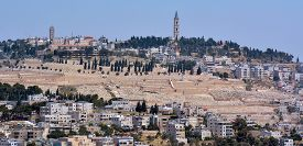 pic of ascension  - Urban landscape view of Jerusalem and the watchtower of the Russian Church of the Ascension on top of mount of olives in Jerusalem Israel - JPG