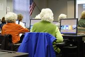 pic of senior-citizen  - senior citizens in college computer lab using modern technology