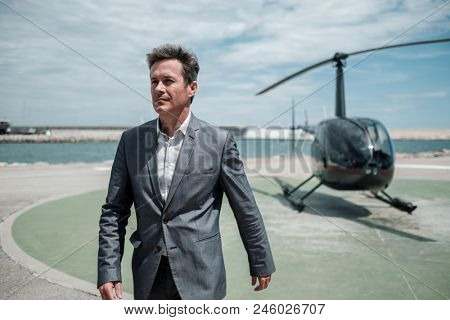 Businessman near private helicopter