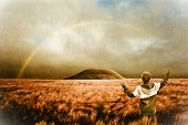 stock photo of humility  - Landscape with rainbow and boy  - JPG