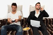image of video game controller  - Gamer and Businessman side by side on the couch - JPG