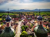 Soaring Majestic Church Saint Maurice In Little French Village Ebersmunster. Aerial Drone View. poster