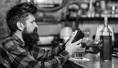 Depressed And Sad Man Sit Alone In Bar Or Pub Near Bar Counter. Hipster Holds Wallet, Counting Money poster